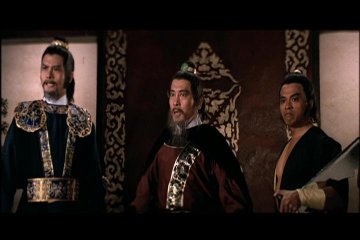 Ku Feng (center)